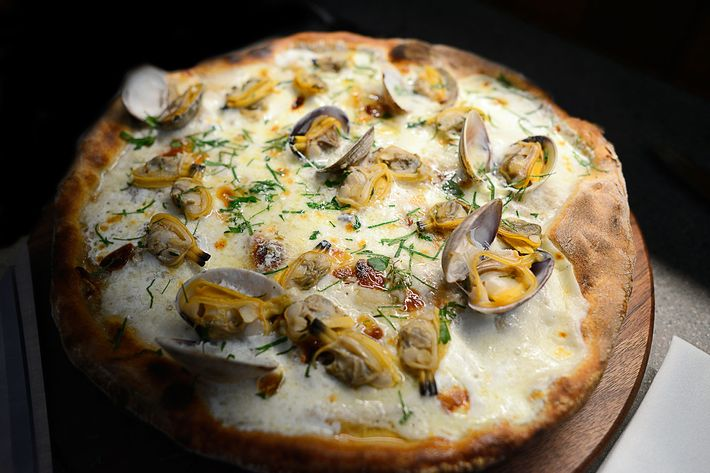 Diners will be given scissors to cut their own vongole pizza, topped with clams, roasted garlic, mozzarella, and herb breadcrumbs.