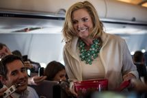 Relaxed and chatty, Ann Romney passes out homemade Welsh Cakes, her grandmother's recipe, and tells the press about how her GOP Convention speech is going and what she'll be wearing, aboard the campaign plane bound for Tampa, in Boston, Massachusetts on Tuesday morning, August 28, 2012.