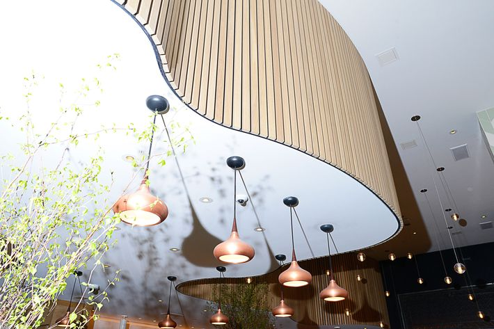 Brass and glass pendants hang from the high ceiling.