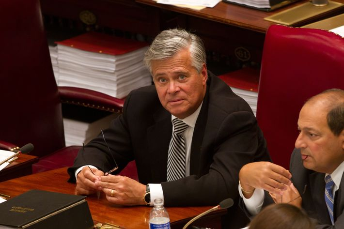 ALBANY, NY - JUNE 16: New York Senate Majority Leader Sen. Dean Skelos (R-District 9) (C) talks with colleagues in the Senate chamber on June 16, 2011 in Albany, New York. The Senate is expected to vote on a bill that would legalize gay marriage as soon as tomorrow. (Photo by Matthew Cavanaugh/Getty Images)