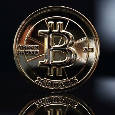 A twenty-five bitcoin is arranged for a photograph in Tokyo, Japan, on Thursday, April 25, 2013. The digital currency, which carries the unofficial ticker symbol of BTC, was unveiled in 2009 by an unidentified programmer, or group of programmers, under the name of Satoshi Nakamoto. Supply is capped at 21 million Bitcoins and managed by a software algorithm embedded into the digital currencys design, rather than a monetary authority such as a central bank.