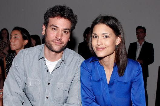 Actor Josh Radnor and actress Julia Jones attend the Honor spring 2013 fashion show during Mercedes-Benz Fashion Week at Eyebeam on September 6, 2012 in New York City.