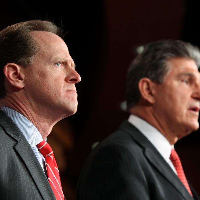 WASHINGTON, DC - APRIL 10: Sen. Pat Toomey (R-PA) (L) and Sen. Joe Manchin (D-WV) speak to the press about background checks for gun purchases, in the U.S. Capitol building April 10, 2013 in Washington DC. The pair is proposing a bipartisan compromise, a proposal to be voted on as an amendment that would expand background checks to firearms sales at gun shows and on the Internet. (Photo by Allison Shelley/Getty Images)
