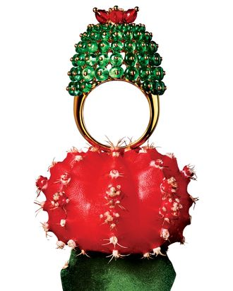 This ring has more than 100 emeralds and five carnelians.