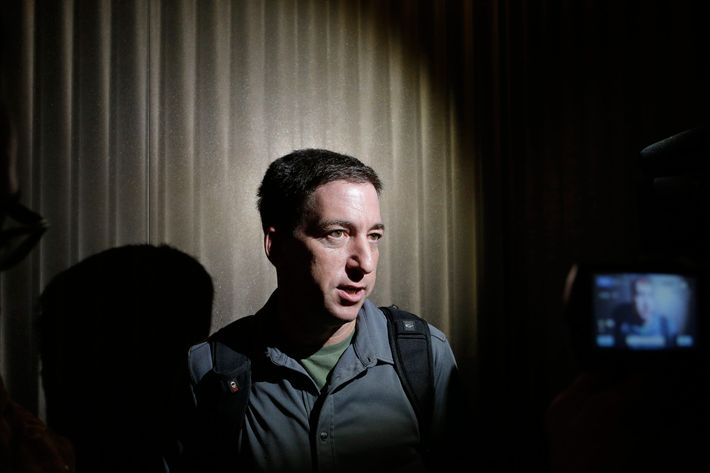 "In this June 10, 2013, file photo The Guardian reporter Glenn Greenwald speaks to reporters at his hotel in Hong Kong. Greenwald first reported former NSA contractor Edward Snowden's disclosure of NSA's government surveillance programs. On Sunday's ""Meet the Press"", June 23, 2013, host David Gregory asked Greenwald why he shouldn't be charged with a crime for having ""aided and abetted"" Snowden. Greenwald replied that it was ""pretty extraordinary that anybody who would call themselves a journalist would publicly muse about whether or not other journalists should be charged with felonies."""