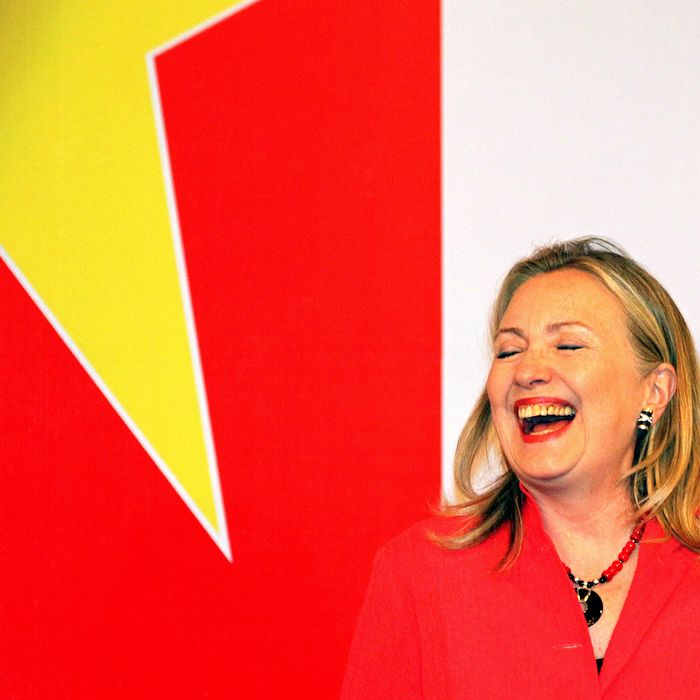 US Secretary of State Hillary Clinton laugh during the American Chamber of Commerce reception and commercial signings ceremony in Hanoi on July 10, 2012. Clinton is visiting Vietnam during a multiple stop tour of Asia where she is expected to meet with leaders and others to strengthen American economic and strategic interests.