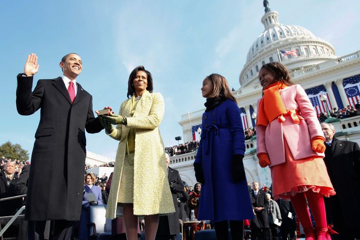 President Barack Obama takes the oath as the 44th U.S. President with his wife, Michelle, by his side at the U.S. Capitol in Washington, D.C., Tuesday, January 20, 2009.
