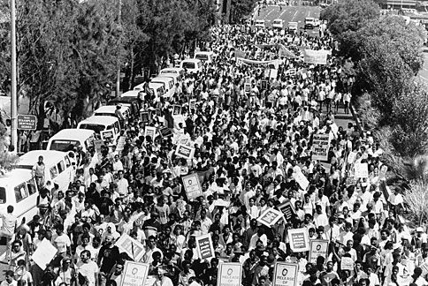 Thousands of protesters march for the release of anti-Apartheid activist Nelson Mandela. Johannesburg, South Africa, circa 1987.