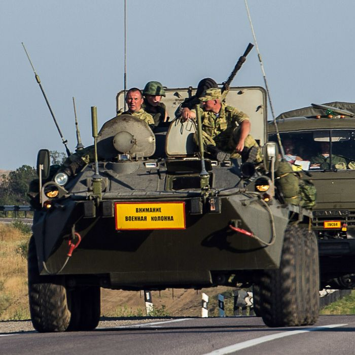 A Ruissian armoured personnel carrier (APC) leads a column of military vehicles on a road near the town of Kamensk-Shakhtinsky in the Rostov region, some 30 km from the Russian-Ukrainian border, on August 15, 2014. Ukrainian officials were preparing to inspect a massive Russian