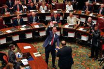 New Senate Majority Leader John Flanagan, R-Smithtown, waves to the gallery before being sworn-in in the Senate Chamber at the Capitol on Monday, May 11, 2015, in Albany, N.Y. Flanagan succeeds Republican Dean Skelos who resigned his position as leader following his arrest on federal corruption charges. (AP Photo/Mike Groll)