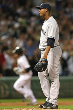 CHICAGO, IL - AUGUST 21:  Starting pitcher Ivan Nova #47 of the New York Yankees reacts as Kevin Youkilis #20 of the Chicago White Sox runs the bases after hitting a grand slam home run in the 5th inning  at U.S. Cellular Field on August 21, 2012 in Chicago, Illinois.  (Photo by Jonathan Daniel/Getty Images)