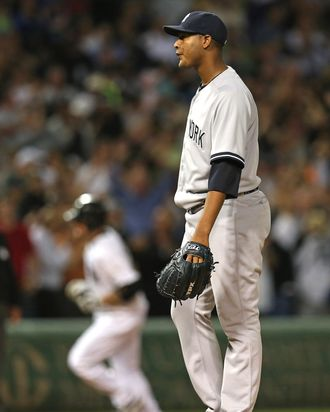 Starting pitcher Ivan Nova #47 of the New York Yankees reacts as Kevin Youkilis #20 of the Chicago White Sox runs the bases after hitting a grand slam home run in the 5th inning at U.S. Cellular Field on August 21, 2012 in Chicago, Illinois.