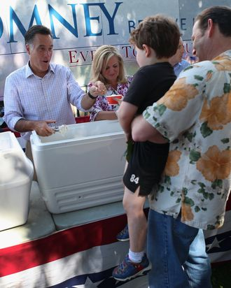 Republican Presidential candidate, former Massachusetts Governor Mitt Romney and his wife Ann Romney scoop ice cream for people during a campaign event at the Milford Ice Cream Social on June 15, 2012 in Milford, New Hampshire. Mr. Romney is starting a five day swing through battle ground states as he battles President Barack Obama for votes.