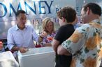 MILFORD, NH - JUNE 15: Republican Presidential candidate, former Massachusetts Governor Mitt Romney and his wife Ann Romney scoop ice cream for people during a campaign event at the Milford Ice Cream Social on June 15, 2012 in Milford, New Hampshire. Mr. Romney is starting a five day swing through battle ground states as he battles President Barack Obama for votes. (Photo by Joe Raedle/Getty Images)