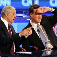MESA, AZ - FEBRUARY 22: Republican presidential candidates (L-R) U.S. Rep. Ron Paul (R-TX), and former U.S. Sen. Rick Santorum talk during a commercial break as they participate in a debate sponsored by CNN and the Republican Party of Arizona at the Mesa Arts Center February 22, 2012 in Mesa, Arizona. The debate is the last one scheduled before voters head to the polls in Michigan and Arizona's primaries on February 28 and Super Tuesday on March 6. (Photo by Justin Sullivan/Getty Images)
