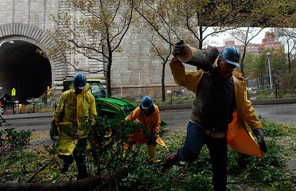 NEW YORK, NY - OCTOBER 30: Workers clean up a fallen tree October 30, 2012 in New York City. The storm has claimed at least 33 lives in the United States, and has caused massive flooding across much of the Atlantic seaboard. US President Barack Obama has declared the situation a 'major disaster' for large areas of the US East Coast including New York City, with wide spread power outages and significant flooding in parts of the city. (Photo by Allison Joyce/Getty Images)
