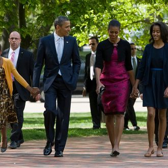 President Barack Obama, First Lady Michelle Obama and daughters Sasha and Malia walk across Lafayette Park to attend Easter Services at St. John's Episcopal Church on April 8, 2012 in Washington, D.C.
