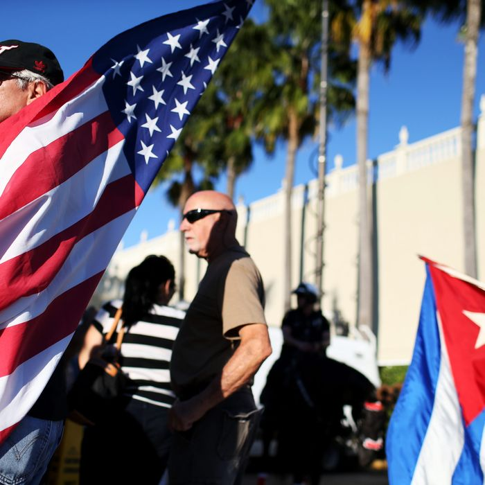 People stand outside the Little Havana restaurant Versailles after U.S. President Barack Obama's announcement on United States-Cuba policy change on December 17, 2014 in Miami, Florida.