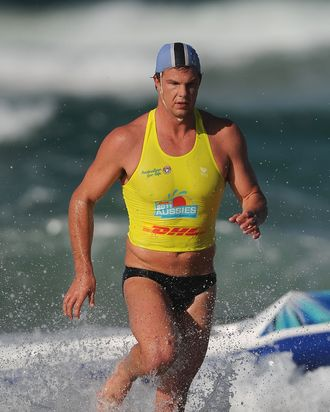 GOLD COAST, AUSTRALIA - APRIL 07: Competitor runs exits the water in the Open Men's Ironman during the 2011 Australian Surf Lifesaving Championships at Kurrawa Beach on April 7, 2011 in Gold Coast, Australia. (Photo by Matt Roberts/Getty Images)