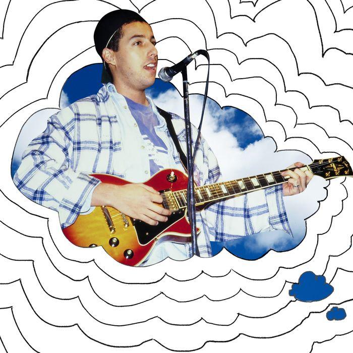 Adam Sandler playing guitar and singing.