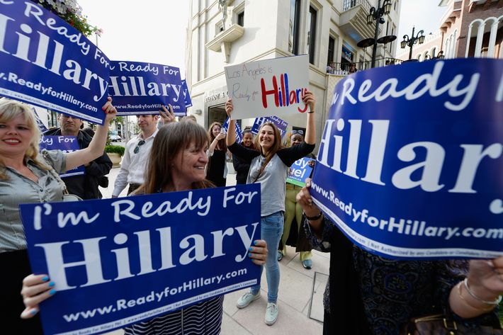 "BEVERLY HILLS, CA - MAY 08:  Volunteers with the national organization ""Ready for Hillary'' hold a rally across the street from the Beverly Wilshire hotel where the former Secretary of State Hillary Rodham Clinton will be honored with the inaugural Warren Christopher Public Service Award at the Pacific Council on International Policy's Chairman's Gala on May 8, 2013 in Beverly Hills, California. Clinton's supporters were urging her to run for president in 2016.  (Photo by Kevork Djansezian/Getty Images)"