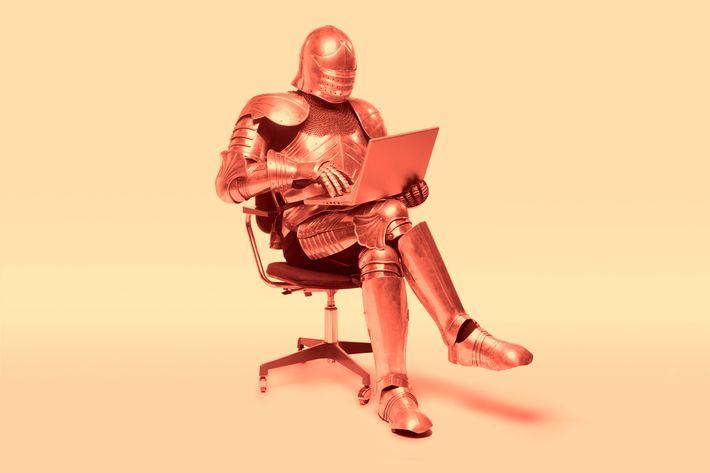 knight in armor using laptop
