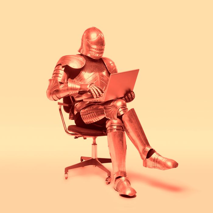 knight in armor using laptop