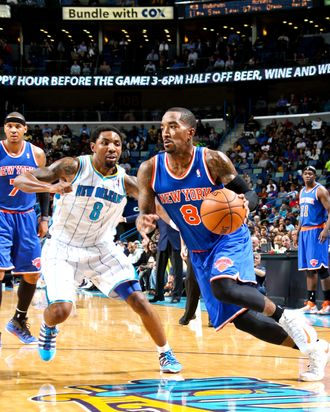 J.R. Smith #8 of the New York Knicks drives against Roger Mason Jr. #8 of the New Orleans Hornets on November 20, 2012 at the New Orleans Arena in New Orleans, Louisiana.
