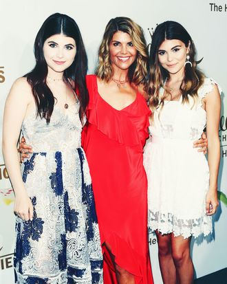 Lori Loughlin (center) with her daughters Bella (left) and Olivia Jade.