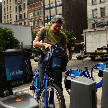 Julie Iovine returns a Citi Bike to a docking station in Union square on May 29, 2013 in New York City. Citi Bike, the long awaited bike sharing program that launched over the Memorial Day weekend in New York, provides 6,000 bikes which are available for short-term rental at 330 stations in Manhattan below 59th Street and parts of Brooklyn. Until June 2nd only members of the Citi Bike program can use the bikes. The bikes will rent daily for $9.95 (plus tax ) or weekly for $25 and will be limited to trips of 30 minutes each. More than 16,000 people have signed up to be members so far.