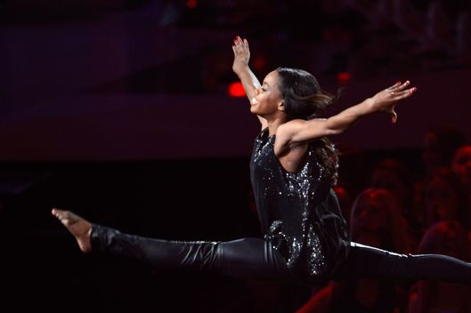 Gabby Douglas performs onstage while Alicia Keys sings during the 2012 MTV Video Music Awards at Staples Center on September 6, 2012 in Los Angeles, California.