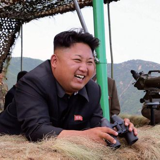 epa04316269 A picture released by the North Korean Central News Agency (KCNA) on 15 July 2014 shows North Korean leader Kim Jong-un (C) attending a live-fire drill by a North Korean artillery unit near the eastern border with South Korea. KCNA reported it on 15 July 2014, without elaborating on the timing of the visit. EPA/KCNA SOUTH KOREA OUT