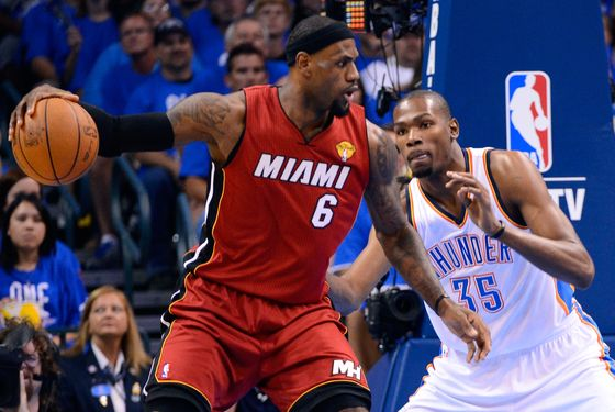 OKLAHOMA CITY, OK - JUNE 12:  LeBron James #6 of the Miami Heat posts up Kevin Durant #35 of the Oklahoma City Thunder in the first quarter in Game One of the 2012 NBA Finals at Chesapeake Energy Arena on June 12, 2012 in Oklahoma City, Oklahoma. NOTE TO USER: User expressly acknowledges and agrees that, by downloading and or using this photograph, User is consenting to the terms and conditions of the Getty Images License Agreement.  (Photo by Ronald Martinez/Getty Images)