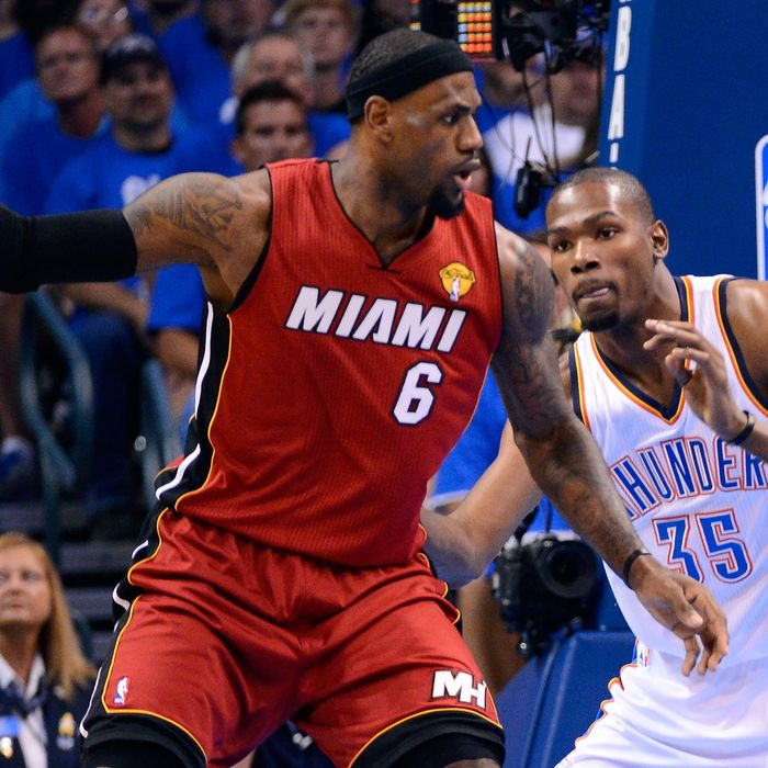 LeBron James #6 of the Miami Heat posts up Kevin Durant #35 of the Oklahoma City Thunder in the first quarter in Game One of the 2012 NBA