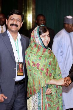 Pakistani education activist Malala Yousafzai (2nd R) shakes hands on July 14, 2014 with Nigerian President Goodluck Jonathan (R) next to her father, Ziauddin Yousafzai (2nd L), and Malala Fund committee member Shiza Shahid (L) at the State House in Abuja. Malala on July 14 urged Jonathan to meet with parents of the schoolgirls kidnapped three months ago by Boko Haram. Malala, who survived a Taliban assassination attempt in 2012 and has become a champion for access to schooling, was in Abuja on her 17th birthday to mark the somber anniversary of Boko Haram's April 14 abduction of 276 girls from a secondary school in the northeast Nigerian city of Chibok. AFP PHOTO  / WOLE EMMANUEL        (Photo credit should read WOLE EMMANUEL/AFP/Getty Images)