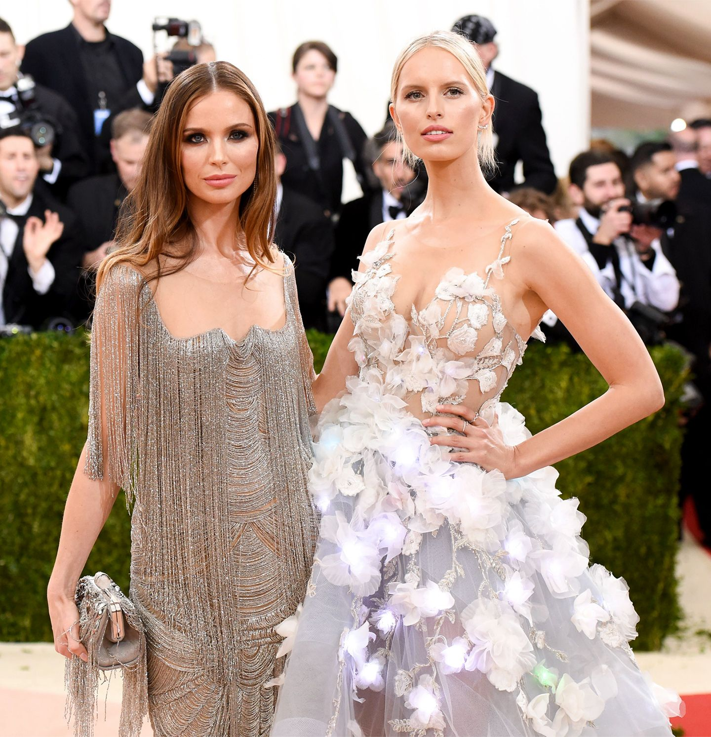 Model Karolina Kurkova posing in the dress next to Georgina Chapman