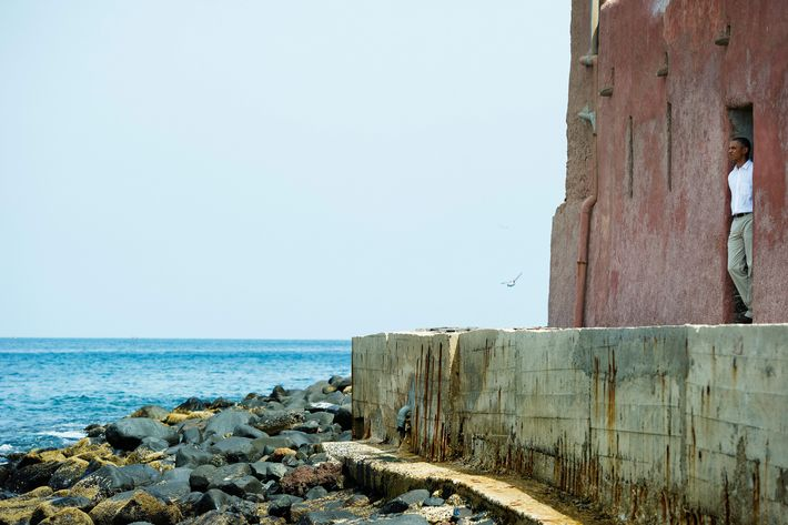 US President Barack Obama looks out from the Door of No Return while touring the House of Slaves, or Maison des Esclaves, at Goree Island off the coast of Dakar on June 27, 2013. Obama and his family toured the museum at the site where African slaves were held before going through the door and being shipped off the continent as slaves.