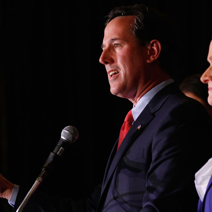 ST. CHARLES, MO - FEBRUARY 7: Republican presidential candidate, former U.S. Sen. Rick Santorum speaks to supporters as his wife, Karen, looks on, February 7, 2012 at the St. Charles Convention Center in St. Charles, Missouri. According to early results, Santorum defeated former Massachusetts Gov. Mitt Romney, former Speaker of the House Newt Gingrich and U.S. Rep. Ron Paul (R-TX) in Missouri, Minnesota nd is leading in Colorado. (Photo by Whitney Curtis /Getty Images)