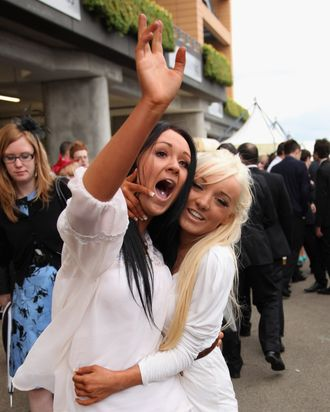 ASCOT, ENGLAND - JUNE 16: Young racegoers revel after the last race on Ladies Day at Royal Ascot on June 16, 2011 in Ascot, England. The five-day meeting is one of the highlights of the horse racing calendar, with 2011 marking the 300th anniversary of the annual event. Horse racing has been held at the famous Berkshire course since 1711. (Photo by Dan Kitwood/Getty Images)
