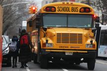 NEW YORK, NY - JANUARY 15: Students walk to board a school bus in Manhattan's East Village on January 15, 2013 in New York City. Drivers of the city's school buses are set to go on strike tomorrow after negotiations with Mayor Michael Bloomberg failed to reach an agreement; over 150,000 children will need to find an alternate method of transportation to school.  (Photo by Mario Tama/Getty Images)