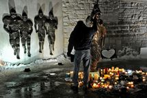 STATE COLLEGE, PA - JANUARY 22: A member of the community pays respect to the statue of Joe Paterno, the former Penn State football coach, outside of Beaver Stadium in the early hours of January 22, 2012 in State College, Pennsylvania. The community was reacting to news that Joe Paterno, who is suffering from lung cancer and who was fired in November in the aftermath of child sex abuse charges against a former assistant, was in serious condition. (Photo by Patrick Smith/Getty Images)