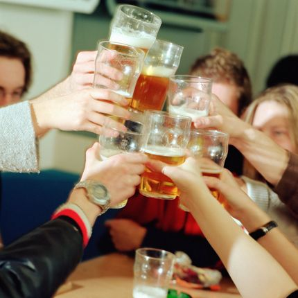 College Students Toasting --- Image by © Image Source/Corbis
