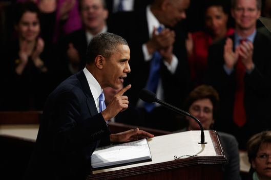 WASHINGTON, DC - JANUARY 28:  U.S. President Barack Obama delivers the State of the Union address to a joint session of Congress in the House Chamber at the U.S. Capitol on January 28, 2014 in Washington, DC. In his fifth State of the Union address, Obama is expected to emphasize on healthcare, economic fairness and new initiatives designed to stimulate the U.S. economy with bipartisan cooperation.  (Photo by Win McNamee/Getty Images)