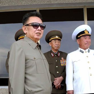 (FILES) This undated file picture released from North Korea's official Korean Central News Agency on September 13, 2009 shows North Korean leader Kim Jong-Il (L) inspecting the Combined Unit 597 of the Korean People's Army (KPA) Navy and its combined maneouvers at an undisclosed location. North Korean leader Kim Jong-Il on September 18, 2009 told a Chinese envoy that he was willing to engage in bilateral and multilateral talks on his country's controversial nuclear programme, Chinese state media said. AFP PHOTO/KCNA via KNS (Photo credit should read KNS/AFP/Getty Images)