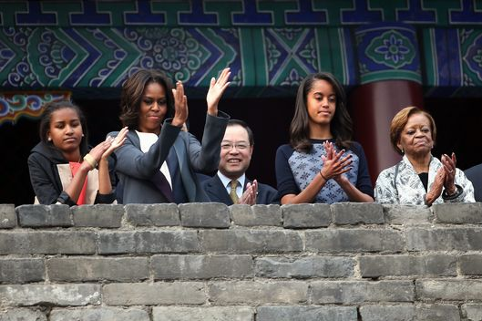 XI'AN, CHINA - MARCH 24:  First Lady Michelle Obama (2nd Left) with her daughters Malia Obama (2nd Right) and Sasha Obama (Left), mother Marian Robinson (Right) visit the Xi'an City Wall on March 24, 2014 in Xi'an, China. Michelle Obama's one-week-long visit in China will be focused on educational and cultural exchanges.  Michelle Obama's one-week-long visit in China will be focused on educational and cultural exchanges.  (Photo by Feng Li/Getty Images)