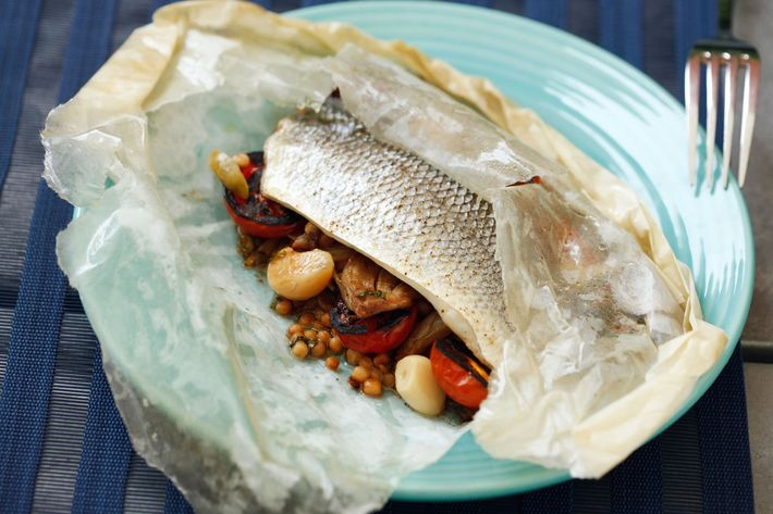 Branzino in cartoccio with olives, fregola, fennel, and garlic.