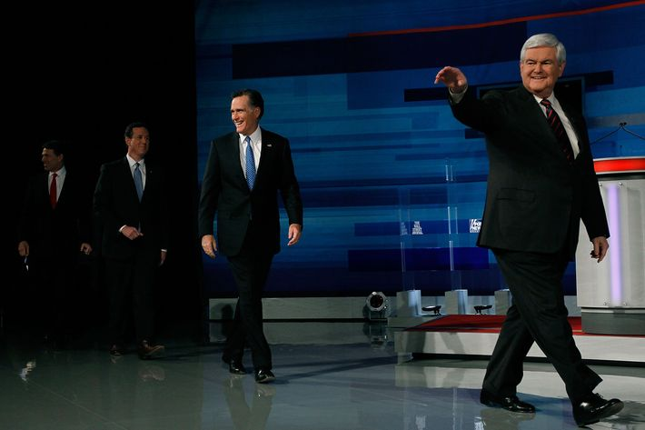 MYRTLE BEACH, SC - JANUARY 16:  Republican presidential candidates (L-R) Texas Gov. Rick Perry, former U.S. Sen. Rick Santorum of Pennsylvania, former Massachusetts Gov. Mitt Romney and former U.S. House Speaker Newt Gingrich walk onstage before participating in a Fox News, Wall Street Journal sponsored debate at the Myrtle Beach Convention Center on January 16, 2012 in Myrtle Beach, South Carolina. Voters in South Carolina will head to the polls on January 21 to vote in the Republican primary election to pick their choice for U.S. presidential candidate.  (Photo by Joe Raedle/Getty Images)