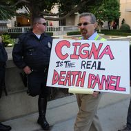 "Members of the group ""Mobilize for Health Care"" protest for healthcare reform at the offices of CIGNA Insurance, a major US health insurer in Los Angeles on October 28, 2009.  Seven members of the group were arrested after they staged a one hour sit-in protest in the lobby of the building housing CIGNA Insurance. Powerful US insurers recently turned on President Barack Obama's top priority health care reform drive, warning the plan would send family medical expenses soaring. Obama has wagered huge political capital on the fight to pass health reform, and to offer affordable care to 46 million people in the United States with no insurance.          AFP PHOTO/Mark RALSTON (Photo credit should read MARK RALSTON/AFP/Getty Images)"