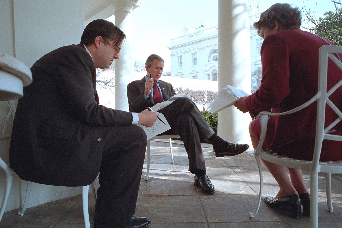 President George W. Bush prepares for his State of the Union Speech with Karen Hughes, Counselor to the President, and Michael Gerson, Director of Presidential Speech Writing, outside the Oval Office January 29, 2002 in Washington DC.