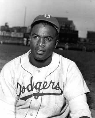 Jackie Robinson poses for a portrait in 1950 before a National League game at Ebbets Field, Brooklyn.